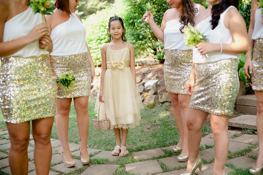 Bridesmaids wearing gold sequin skirts.