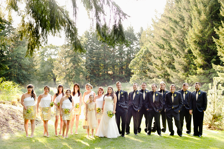Bridesmaids in wedding party with gold-sequined skirts.