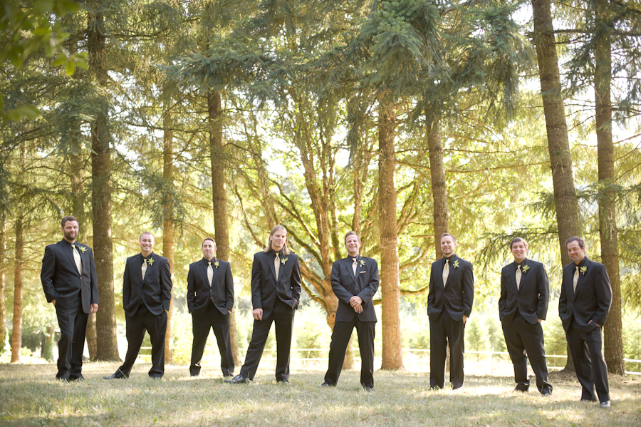 Groomsmen in black suits with gold ties.