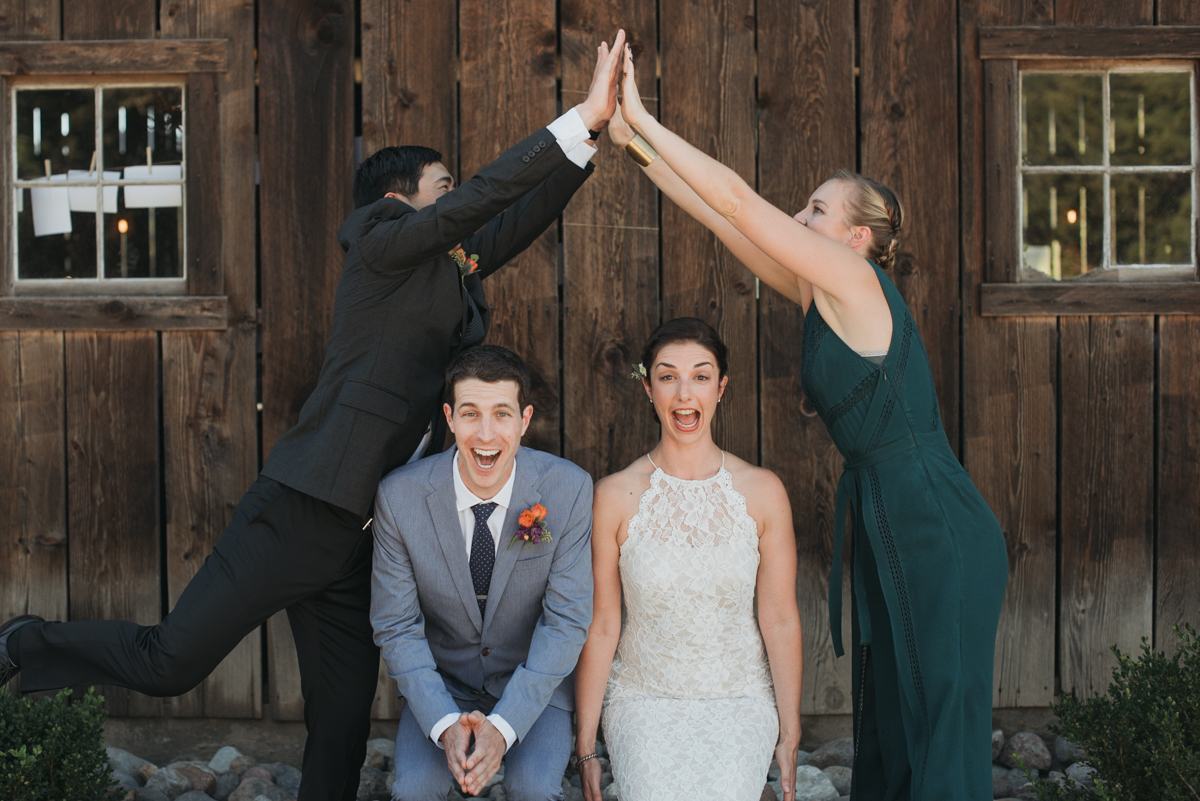 bride and groom wedding party high-five