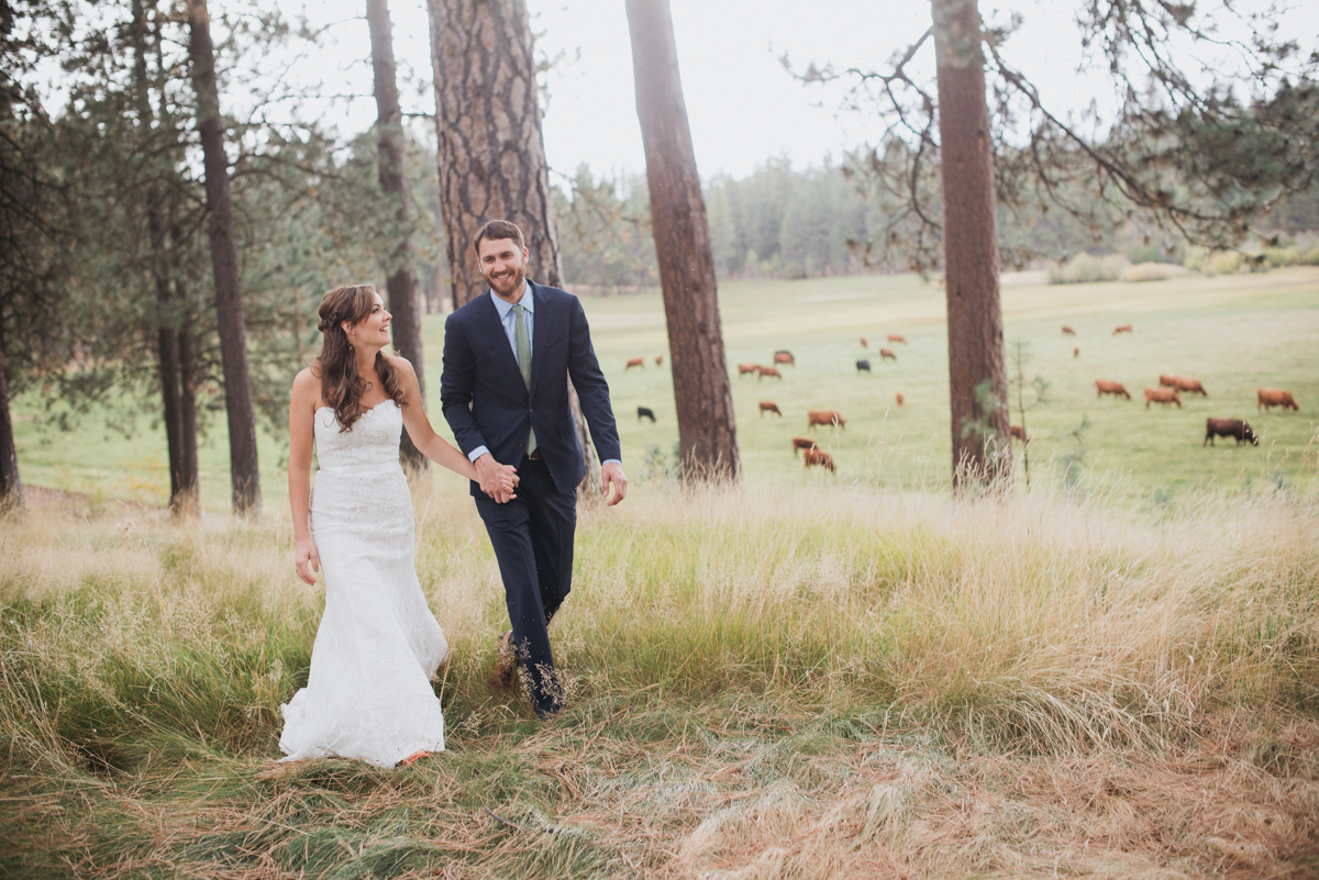 Bride & Groom in a cow pasture at House on Metolius.